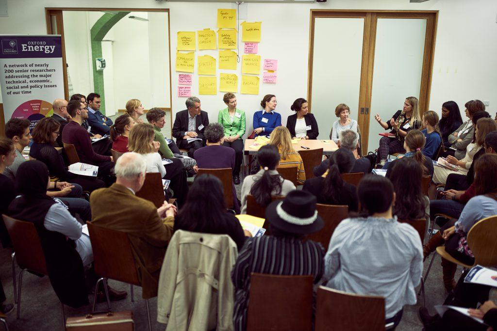 Delegates talking in a seminar room