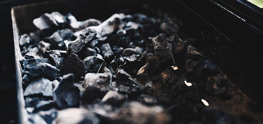 Close up shot of a bucket of coal