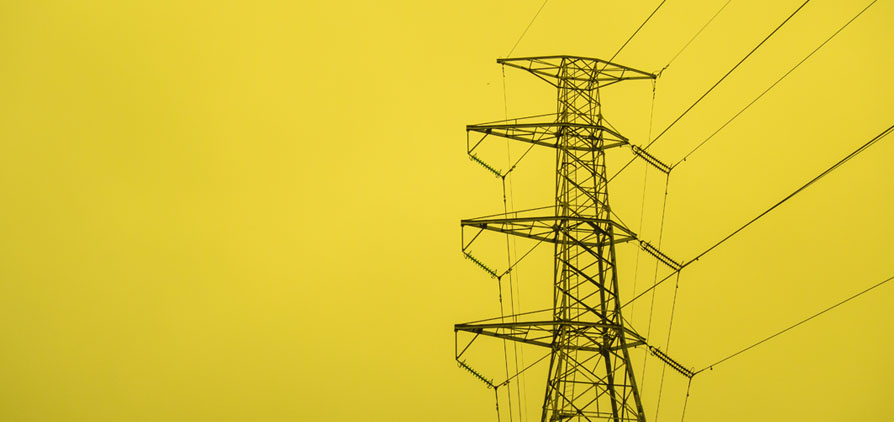 Electricity pylon with a yellow background