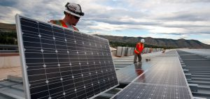 People installing solar panels